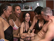 Lapdancers compete to see which is the best dancer by stripping and wanking guy's cock